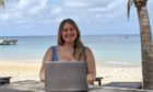 Catherine working remotely in Anguilla.