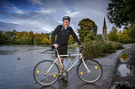 Paul English with his uncle's old bike at Queen's Park, Glasgow