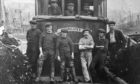 A fishing crew on board the Kirkcaldy-registered vessel Pursuit in the early 1900s, kitted out in jerseys