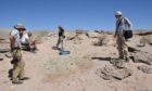 Members of a University of Edinburgh-led team in the Gobi Desert in Mongolia where they discovered multiple complete skeletons of a new species of toothless, two-fingered dinosaur named Oksoko avarsan