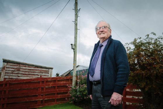 Andy Welsh by the pole in his garden in Locharbriggs