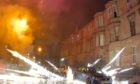 A firework explodes in Kenmure Street, Pollokshields, Glasgow at Halloween last year