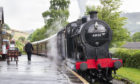 steam train trundles into Oakworth station on the Keighley and Worth Valley heritage line as featured in the reboot of All Creatures Great And Small