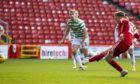 Aberdeen's Lewis Ferguson nets a penalty in the 3-3 draw with Celtic