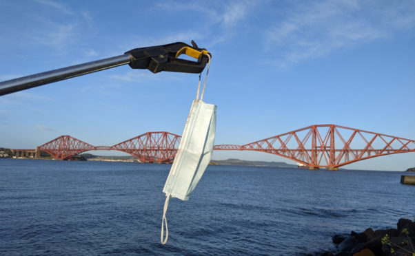 A surgical mask found during a litter cleanup near the Forth Bridge