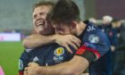 Scotland's Scott McTominay (left) and Declan Gallagher celebrate after David Marshall saves Aleksandar Mitrovic's penalty