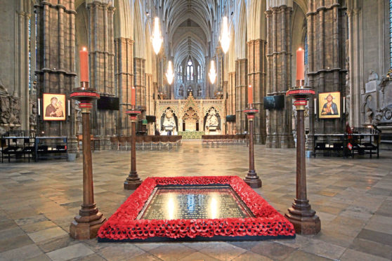 The Grave of the Unknown Warrior inside Westminster Abbey has four candles placed at each of the four corners during Remembrance.