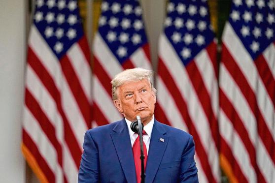 President Donald Trump speaks in the Rose Garden of the White House in Washington.