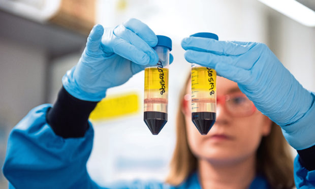 A University of Oxford researcher in a laboratory at the Jenner Institute working on the coronavirus vaccine developed by AstraZeneca and Oxford University.