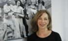 Kathrine Switzer stands in front of the famous picture of her manhandling at the 1967 Boston Marathon as she became the first woman to run the race.