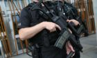 Armed, offensive:  Ex members of a police gun unit claim gagging orders are used to close down bids to expose macho culture