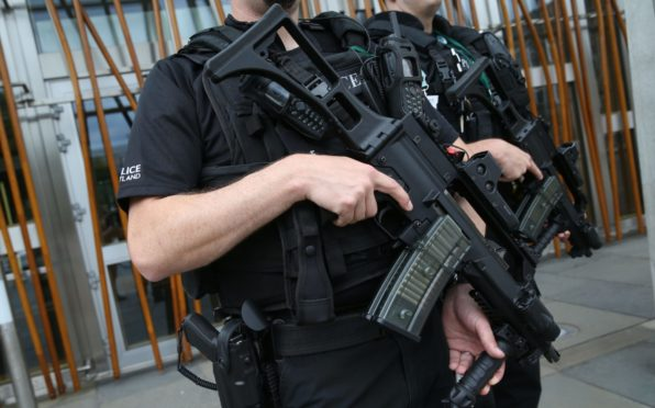 Armed, offensive:  Ex members of a police gun unit claim gagging orders are used to close down bids to expose macho culture.