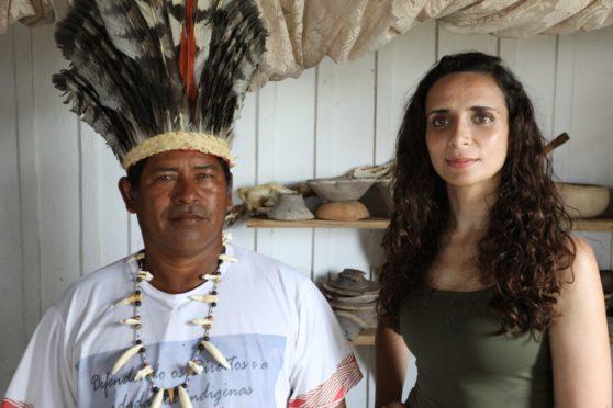 Archaeologist Ella Al-Shamahi with chief Anildo Kokama of the Kokama community, who hopes archaeology can help his people's claim to ancient tribal territory on the river Amazon in Brazil.