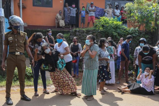 Sri Lankan families plead for the lives of relatives amid riots in Mahara Prison, Colombo, in November 2020. Eight inmates were killed and 40 injured when prison and police officials opened fire at rioters