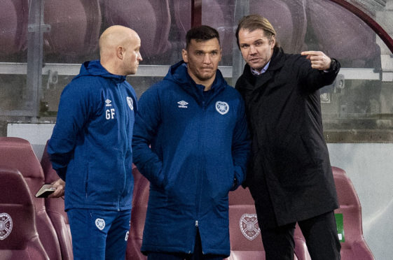 Robbie Neilson explains his thinking to his backroom staff, Gordon Forrest and Lee McCulloch