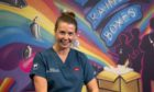 Nurse Alison Williams in front of Rainbow Boxes mural