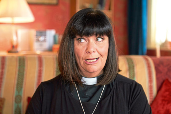 Dawn French once again dons her dog collar for The Vicar Of Dibley
