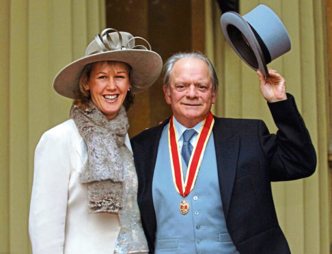 Sir David Jason and his wife Gill after collecting his knighthood.