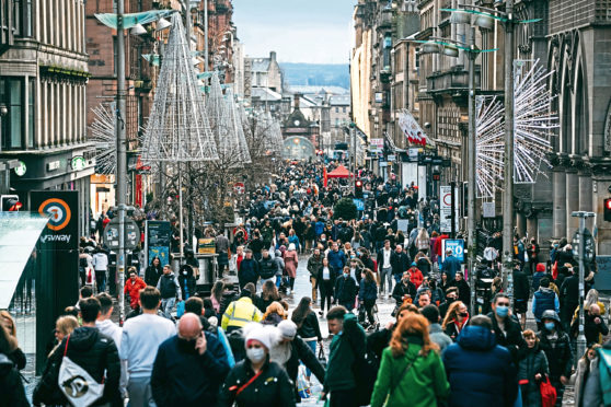 Buchanan Street in the centre of Glasgow was mobbed with shoppers yesterday on the last Saturday before Christmas.
