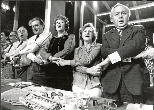 Harold Wilson and Barbara Castle, right, lead the chorus of Auld Lang Sang at Labour                     Party conference in 1973.