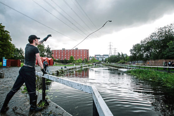 Magnet Fishing, in a canal in the Possil area of Glasgow.