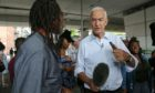 Newsreporter Jon Snow for ITN interviews local residents of Grenfell Tower.