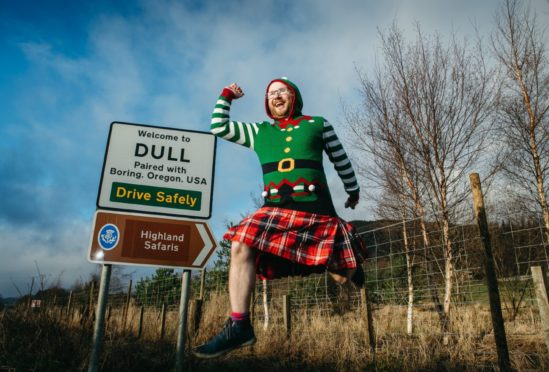 Jamie Pringle shows off the special tartan he created to mark the tie-up between Dull and Boring