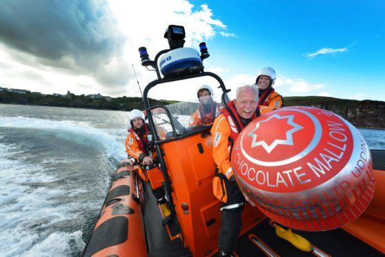 Sir Boyd Tunnock and crew aboard St Abbs Lifeboat