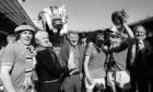 Tommy Docherty, centre, with (l-r) Stuart Pearson, Tommy Cavanagh, Lou Macari, Gordon Hill and Frank Blunstone after winning the FA Cup