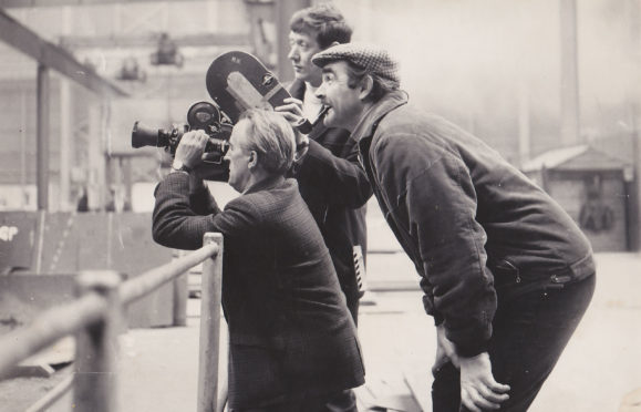 Sean Connery whilst shooting The Bowler &The Bunnet in Glasgow's Fairfield Shipyards in 1967, with STV cameraman Bill Scott