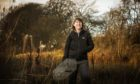 Volunteer Ali Thornton from the Scottish Invasive Species Initiative carries a trap at the Tay Reedbeds