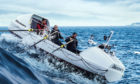 Jamie Douglas-Hamilton and the team of rowers battle through the waves as they cross the infamous Drake Passage
