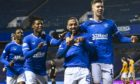 Roofe, seen celebrating one of his goals against Motherwell last Saturday, has become a big player for Rangers recently.