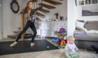 Ballet star Iana Salenko, with son William, works out at home in Berlin, Germany.