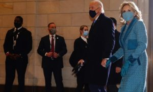President-elect Joe Biden (L) and Dr. Jill Biden (R) arrive at the East Front of the US Capitol for his inauguration ceremony to be the 46th President of the United States.