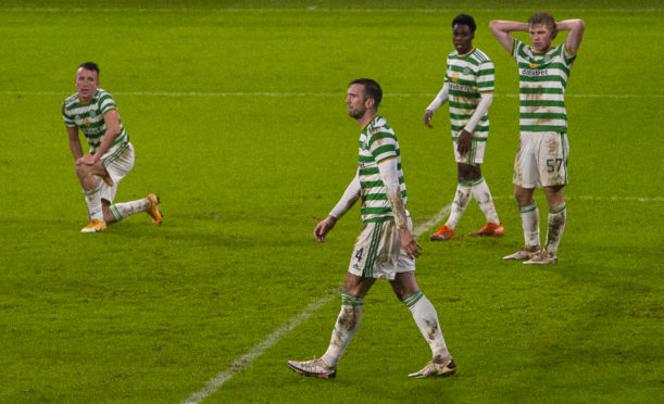 Celtic's depleted squad dropped more points against Hibs, 24 hours after Steven Gerrard had guided Rangers to another three points at Pittodrie