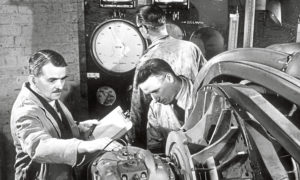 Frank Whittle, left, and colleagues work on first jet engine