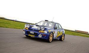 Marino Franchitti driving Colin McRae's Subaru.