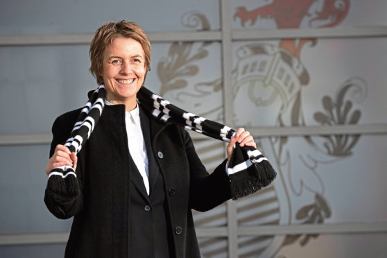 Leeann Dempster looks delighted with her new role at Queen's Park