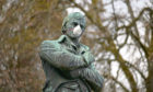 A statue of Scotland's national bard Robert Burns wearing a mask during the Coronavirus pandemic.