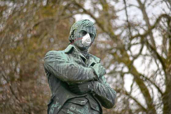 A statue of Scotland's national bard Robert Burns wearing a mask during the Coronavirus pandemic.