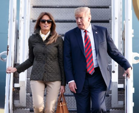 Donald and Melania Trump disembark Air Force One during their 2018 trip to the UK