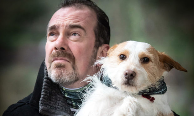 Gavin Mitchell and his dog Bob get into character