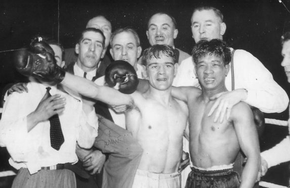 Benny Lynch, left, and rival Small Montana with their corner men after the bruising bout that made Lynch world champion without dispute