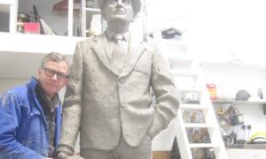Sculptor David Annand with his statue of Chic Murray.