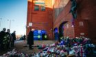 John Greig paying his respects outside Ibrox