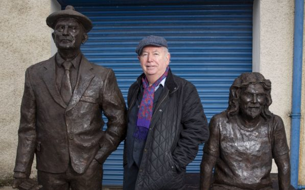 Colin Beattie with David Annand's sculpture of comedy legends Chic Murray and Billy Connolly