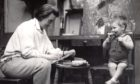 Joan Eardley sketching a little boy in her studio in Townhead, Glasgow