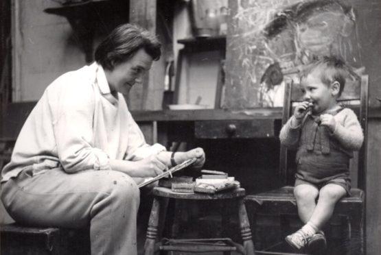 Joan Eardley sketching a little boy in her studio in Townhead, Glasgow