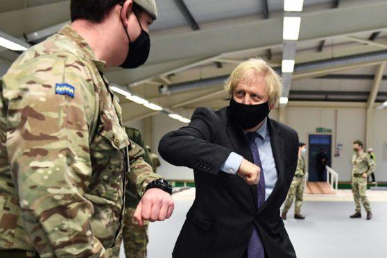 Boris Johnson meets troops setting up a vaccination centre in Castlemilk